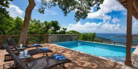 Coral Sky Villa pool deck loungers and Coral Bay view